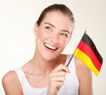 stock-photo-13080619-smiling-young-woman-with-germany-flag